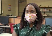 Masked teacher speaking to ETV about plans for return to school