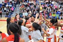 Williams 8th Grade Girls Basketball team holding championship trophy
