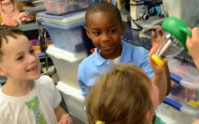 Three elementary students engaged in a Science lesson