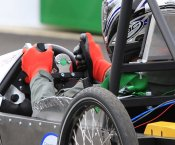 Student driving a Greenpower car during a race