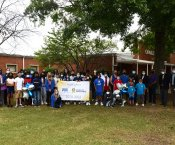 Highlands PTA, students, school, and district staff holding a National PTA School of Excellence Banner