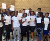 Jemison Band Seniors holding up their college acceptance letters