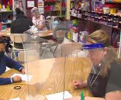 Mrs Bergeson and Hendricks teaching ESOL behind desk shields
