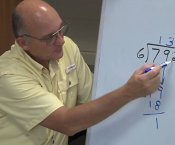 Mr. Bill Sanner teaching math on a whiteboard
