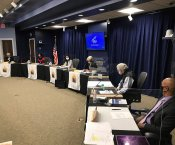 HCS Board of Education on November 2, 2020 seated behind plexiglass protection barrietd