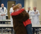 Sgt. Desiree Lancey hugging her son Kael