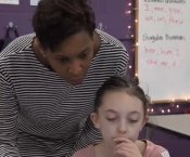 Chanel Leslie helping one of her students out.