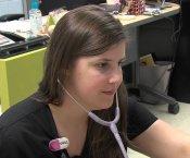Huntsville High Nurse Hipp checking the vitals of a student