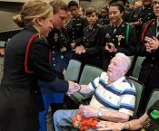 JROTC Student Shaking Hands with LTC (Ret.) Johnnie Richardson