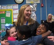 Ms. Josie Craig being hugged by students after learning she was the HCS Teacher of the Year