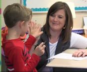 Ms. Kristen Jackson high-fiving a student