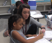 Rebecca Ramsey helping a student with math work