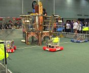 Robots at the Robotics Competition moving balls around an arena