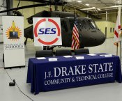 SES MOU Signing Table with Helicopter in Background
