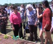 Seniors and students at the new Grissom Community Garden