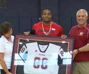 Trey Flowers being awarded a framed Columbia Jersey