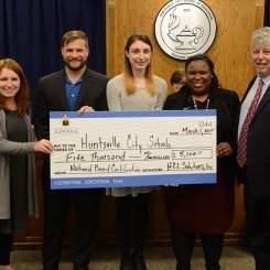 H2L presenting a giant $5,000 check to Dr. Akin and HCS Board
