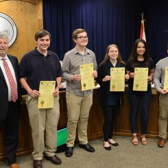 Grissom Academic team receiving board resolution with Dr. Akin.