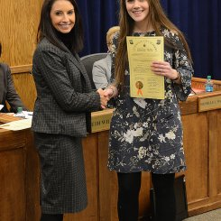 Charis Harrison receives board resolution from Superintendent Finley for being a National Merit Semifinalist