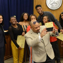 Coach takes selfie with Jemison Track team after being recognized by board and Superintendent Finley
