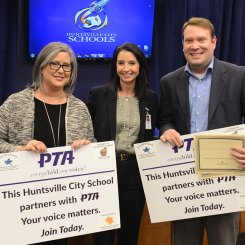 Paula Thompson & Stewart Thorson receive PTA recognition alongside Superintendent Finley