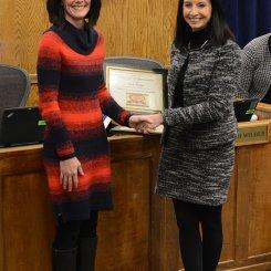 Ms. Beth Wilder receiving a board resolution from Superintendent Finley for Board Appreciation Week